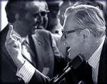 Governor Nelson A. Rockefeller giving inmates finger