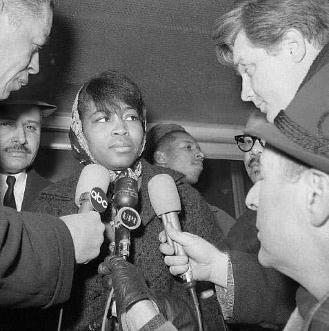 1965-Betty Shabazz wife of Malcolm X speeking to press.